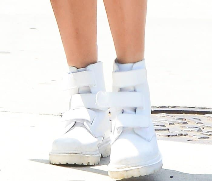 "Hailey Baldwin wearing Dr. Martens ""Coralia"" boots in white Venice leather while out and about in Beverly Hills"