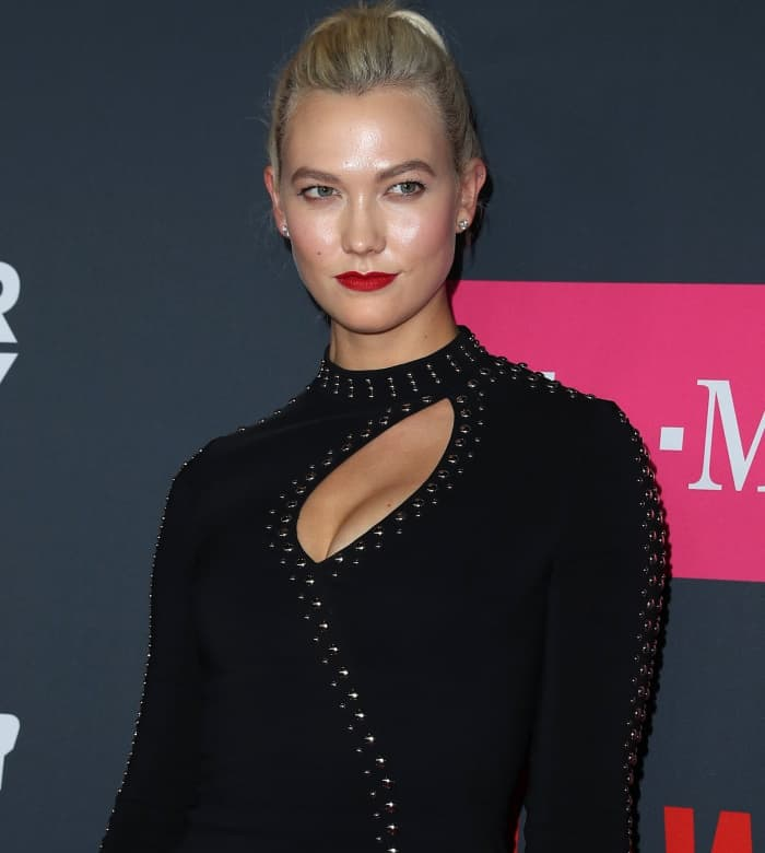 Karlie Kloss wearing a studded black dress at the Mayweather vs. McGregor pre-fight VIP party
