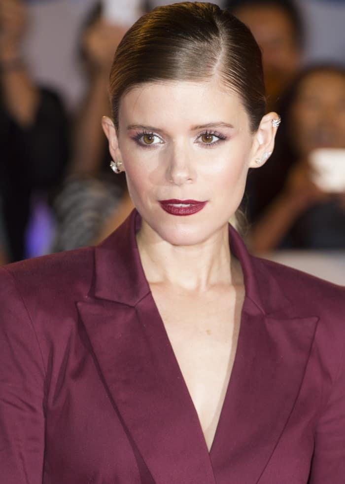 "Kate Mara wearing a maroon two-piece suit at the ""My Days of Mercy"" premiere during the 2017 Toronto International Film Festival"