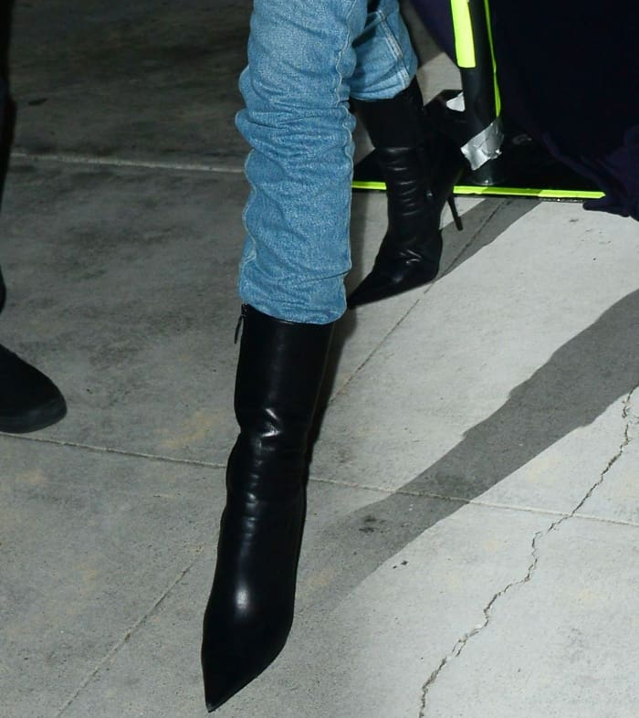 Kendall Jenner wearing Balenciaga black leather pointy-toe ankle boots while leaving a church service in Beverly Hills