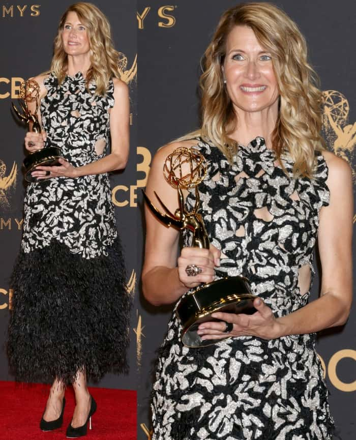 Laura Dern showing off her award for Outstanding Supporting Actress at the 69th Emmy Awards press room