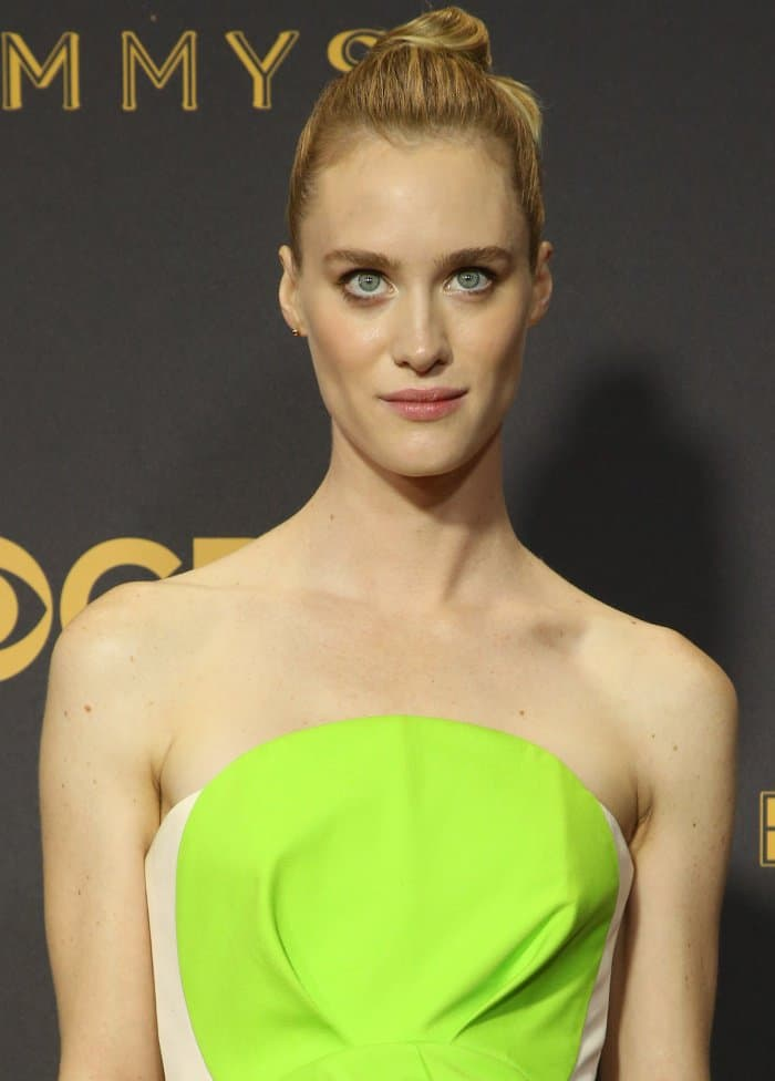 Mackenzie Davis with a sculptural updo, minimal makeup, and jewelry from Tiffany and Anita Ko