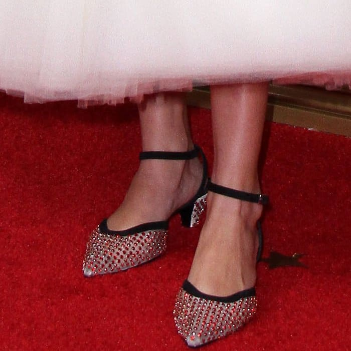Millie Bobby Brown wearing Calvin Klein 205W39NYC embellished slingback pumps at the 69th Emmy Awards