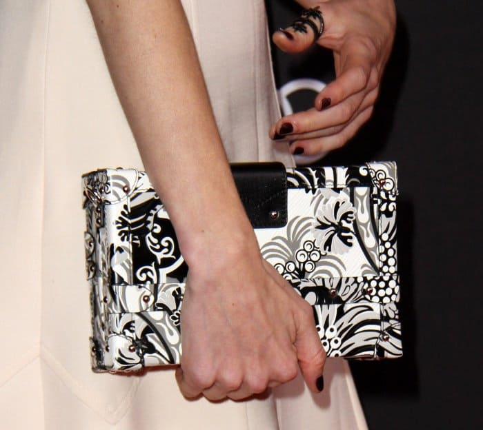 Natalia Dyer carrying a patterned black-and-white box clutch at the Television Academy 69th Emmy Performer Nominees Cocktail Reception