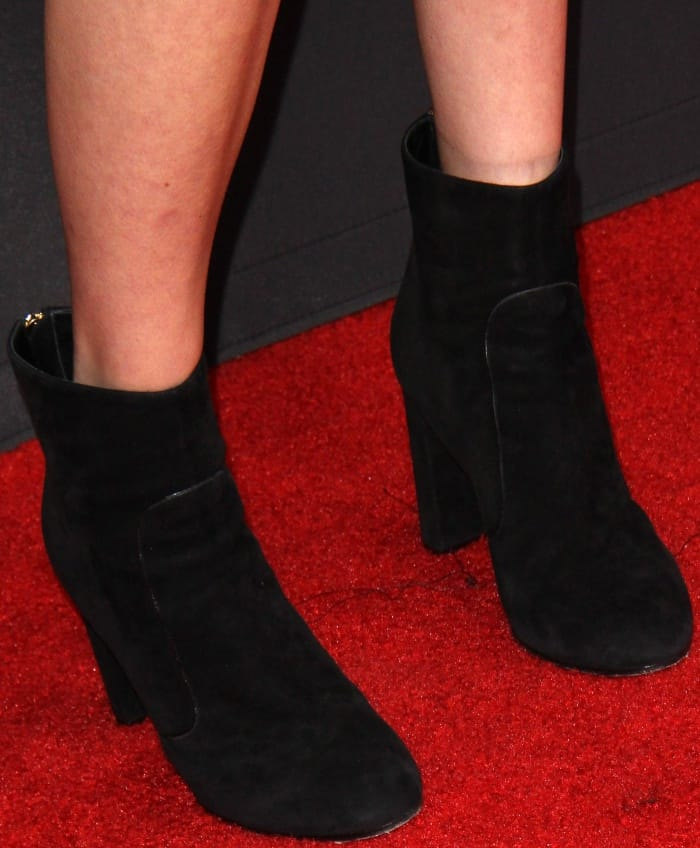 Natalia Dyer wearing black suede ankle boots at the Television Academy 69th Emmy Performer Nominees Cocktail Reception