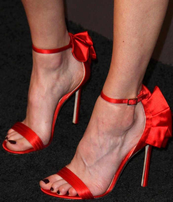 Natalia Dyer wearing red ankle-strap sandals at Audi's exclusive event celebrating the 69th Emmy Awards
