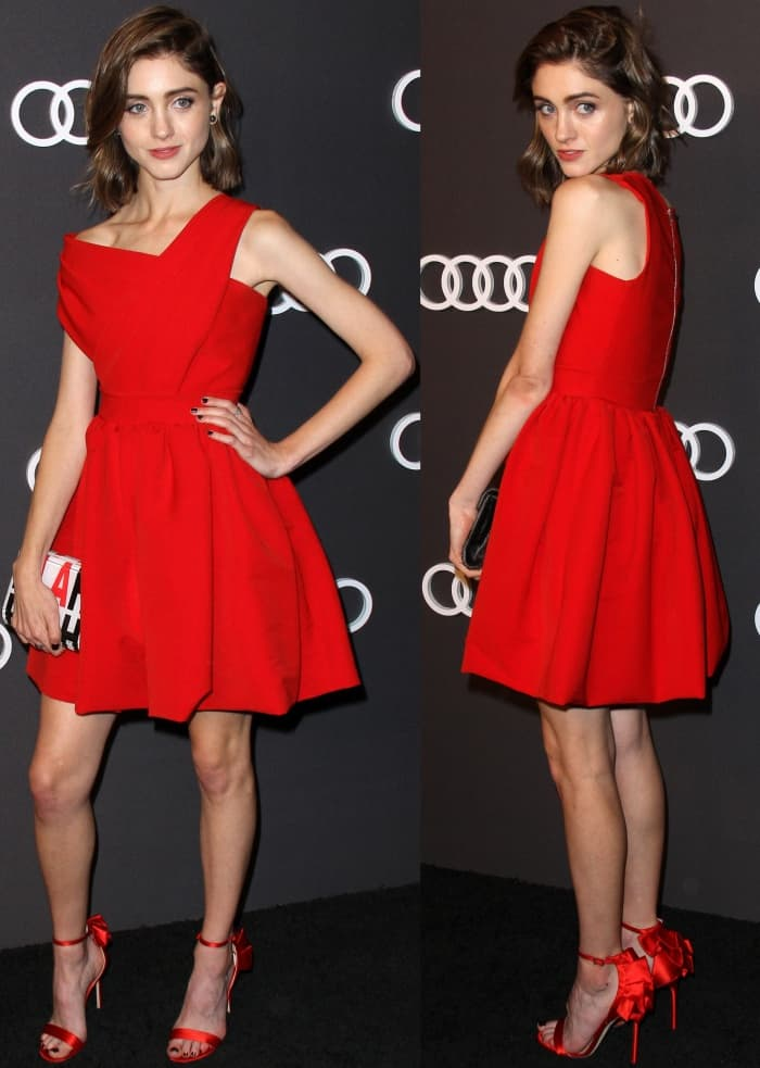 """Natalia Dyer wearing the Preen by Thornton Bregazzi """"Damaris"""" dress and red ankle-strap sandals at Audi's exclusive event celebrating the 69th Emmy Awards"""