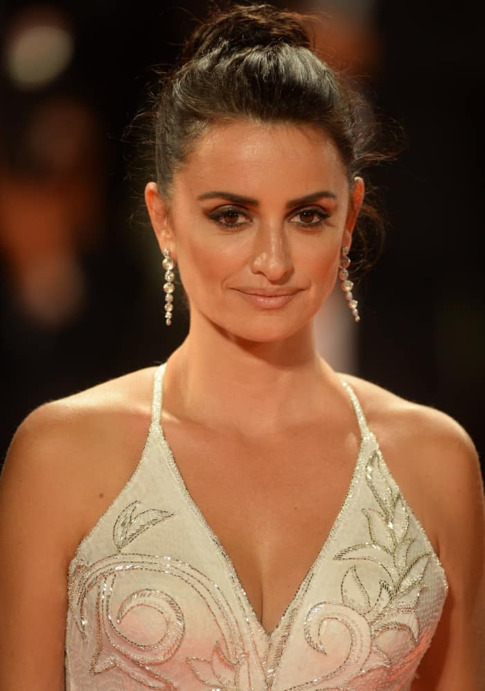 "Penelope Cruz wearing a custom Atelier Versace gown at the ""Loving Pablo"" premiere during the 74th Venice Film Festival"