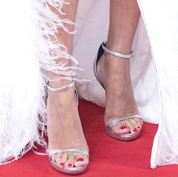 "Penelope Cruz wearing Versace metallic silver sandals at the ""Loving Pablo"" premiere during the 74th Venice Film Festival"