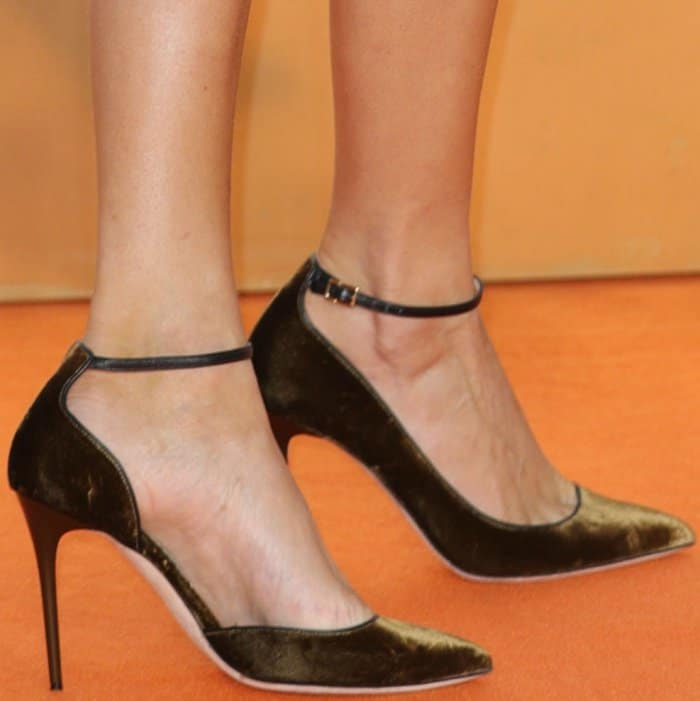 "Poppy Delevingne wearing black ankle-strap pumps at the ""Kingsman: The Golden Circle"" world premiere"
