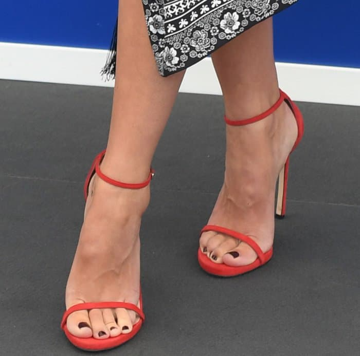 Rebecca Hall wearing red ankle-strap sandals at the 74th Venice Film Festival jury photocall