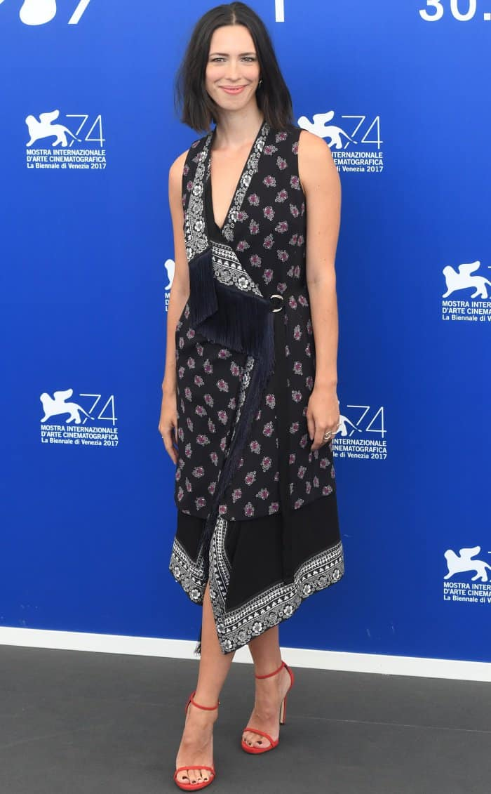 Rebecca Hall wearing an Altuzarra Resort 2018 dress and red ankle-strap sandals at the 74th Venice Film Festival jury photocall