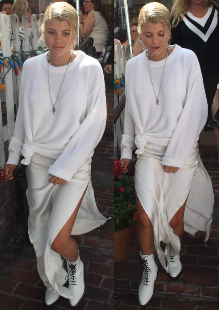 """Sofia Richie wearing an all-white ensemble styled with The Row """"Fara"""" lace-up leather combat boots"""