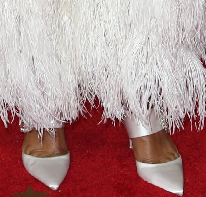 Tracee Ellis Ross wearing Roger Vivier white satin pointy-toe pumps at the 2017 Emmy Awards