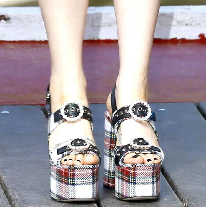 Zosia Mamet wearing Miu Miu tartan platform sandals at the 74th Venice Film Festival