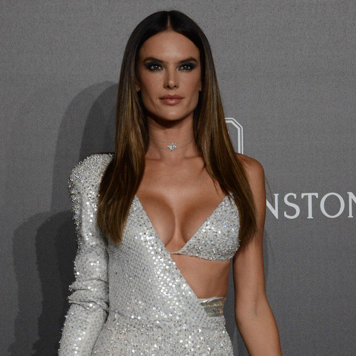 Alessandra Ambrosio made a sultry entrance in a sparkly silver gown from Julien Macdonald's Fall 2017 collection, which featured one long sleeve, a triangle bikini top and a sexy thigh-high slit