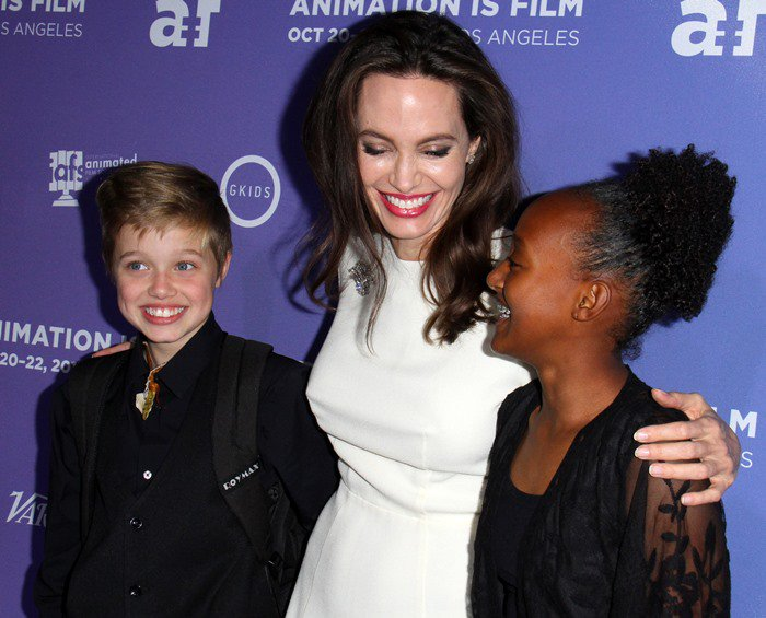 Angelina Jolie posing with her children, Shiloh Nouvel Jolie-Pitt and Zahara Marley Jolie-Pitt