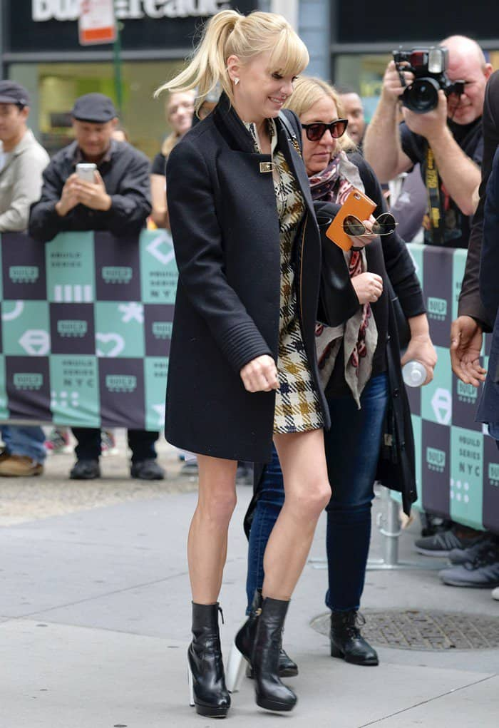 Anna Faris leaving AOL Build in New York wearing a yellow-brown check pattern dress on October 23, 2017