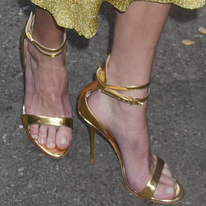 Anna Faris wearing ankle-strap sandals by Sophia Webster