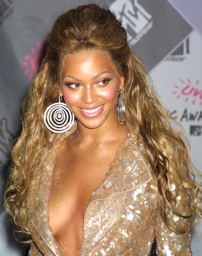 Beyonce Knowles wearing a sparkling champagne-colored dress at the MTV Music Awards held at Radio City Music Hall in New York City on August 28, 2003