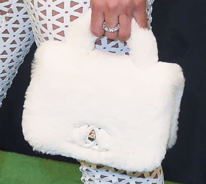 Chyna brought some fun into the look with a vintage Chanel fur tote