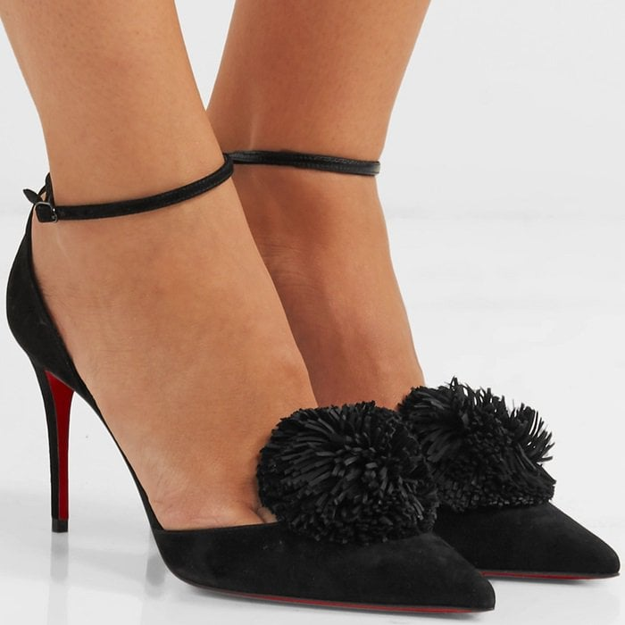 """Described by the French shoe maestro as the """"party season"""" shoe, these 'Tsarou' pumps are crafted from butter-soft suede and topped with an oversized pompom"""