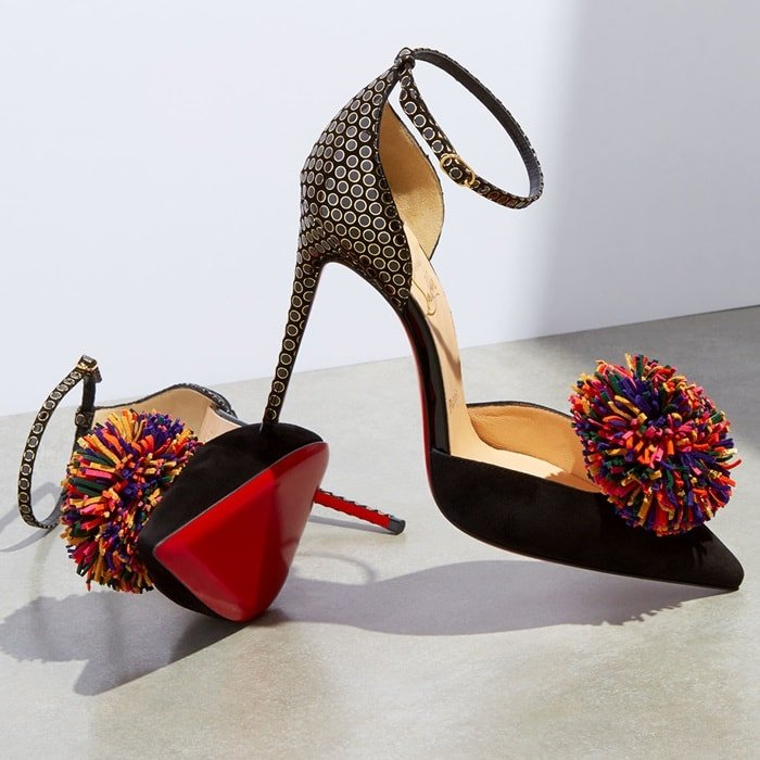 These playful pumps are embellished with multicolored pompoms and printed with black and gold polka-dots