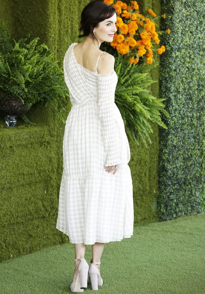 The actress shows off the back of her Adeam Resort 2018 gingham dress