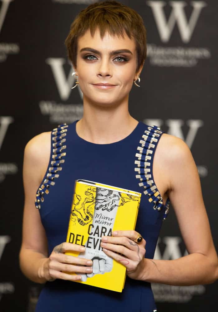 "Cara Delevingne signs copies of her debut novel ""Mirror Mirror"" in London on October 4, 2017"