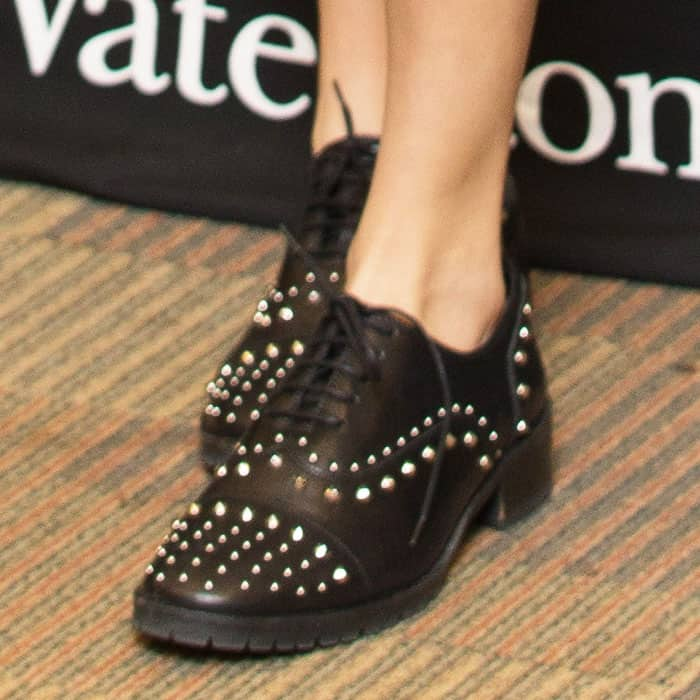 Cara takes the studs all the way to her feet with a pair of derbys by The Kooples