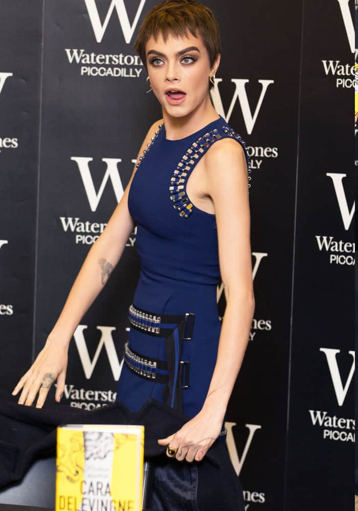 Cara jokes around with the press at her book launch