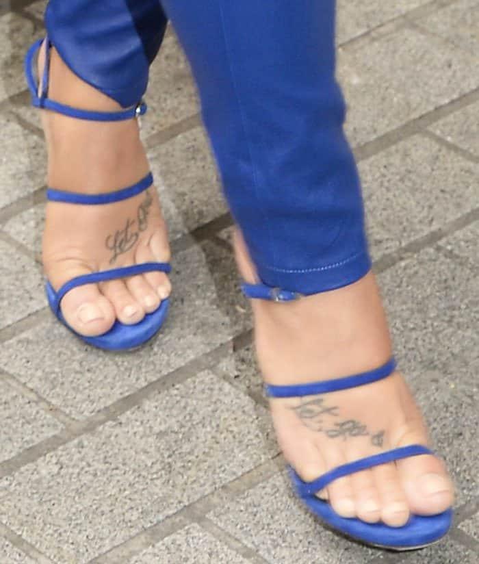 Demi Lovato matches her pants with blue Stuart Weitzman Courtesan shoes