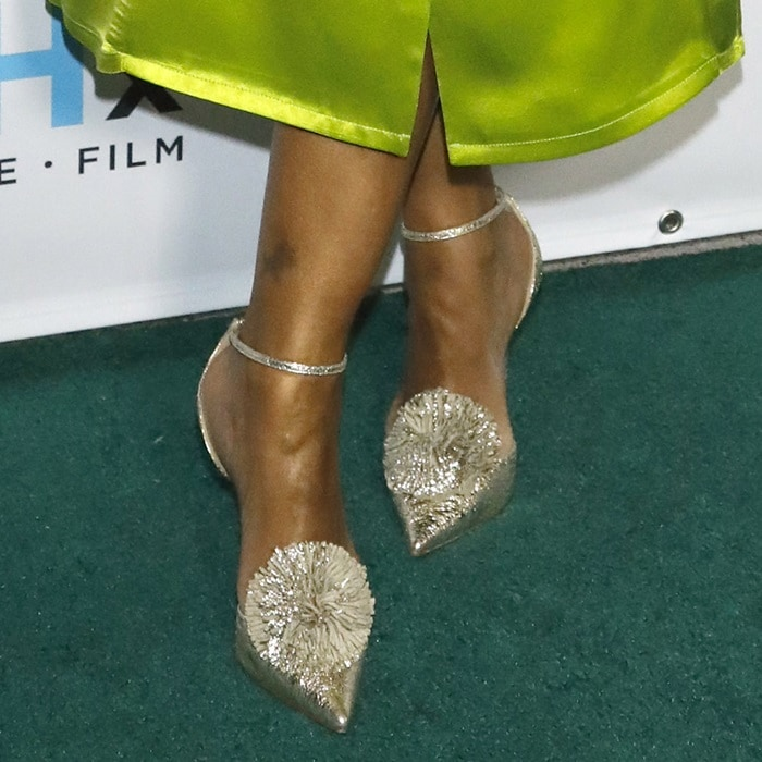 "Garcelle Beauvais's feet in ""Tsarou"" pompom-embellished leather pumps"