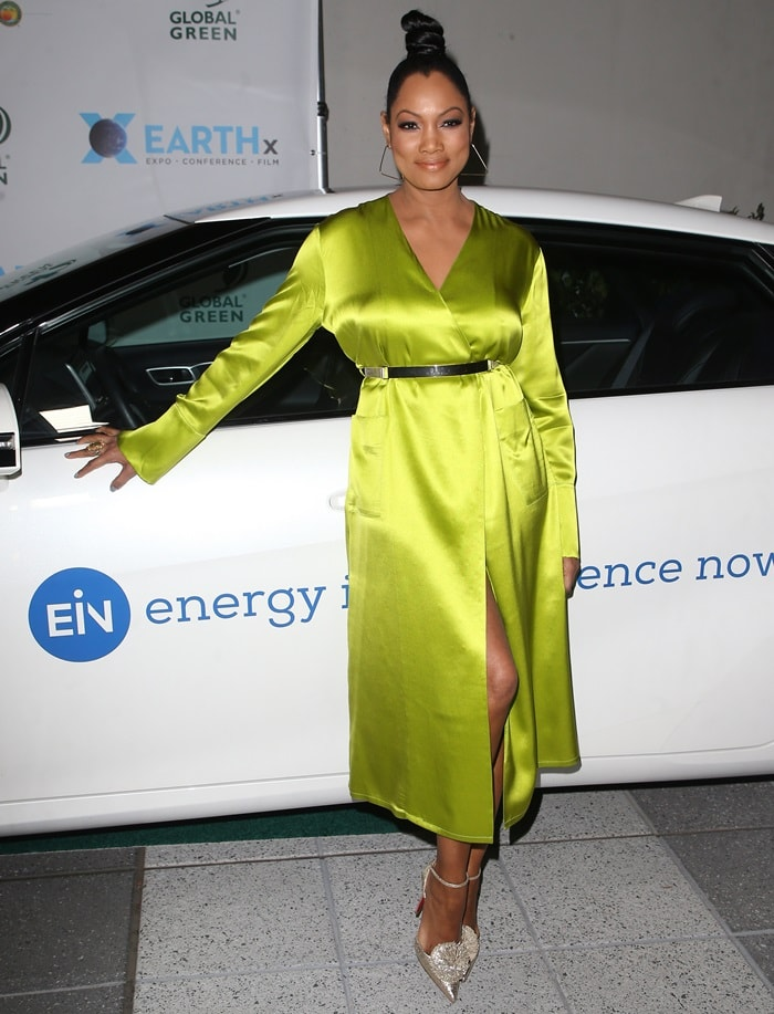 Garcelle Beauvais wearing a lime green robe dress at the 2018 Global Green Pre-Oscar Gala in Los Angeles on February 28, 2018