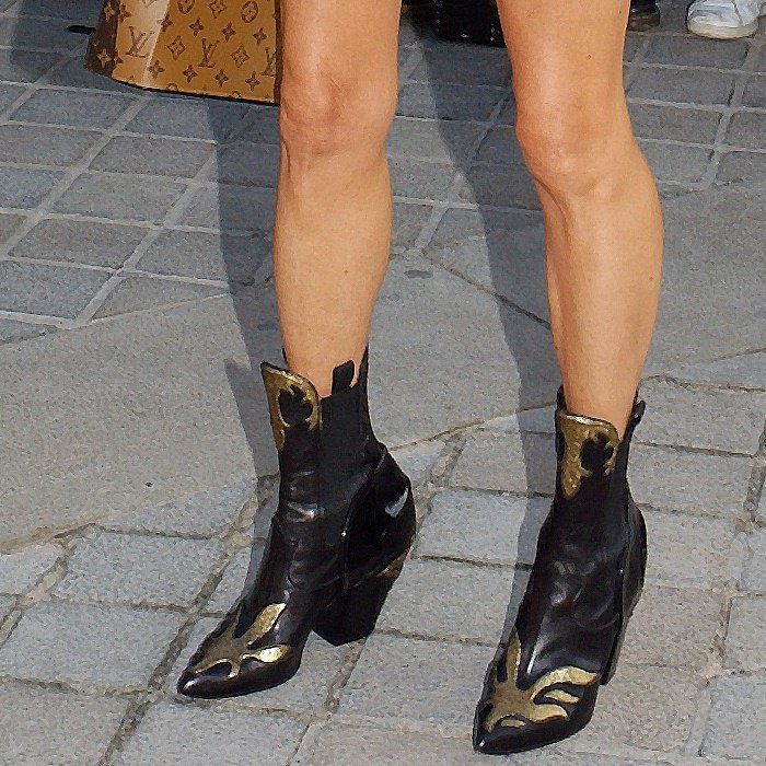 Jennifer wears an unreleased pair of boots from the Louis Vuitton Cruise 2018 collection