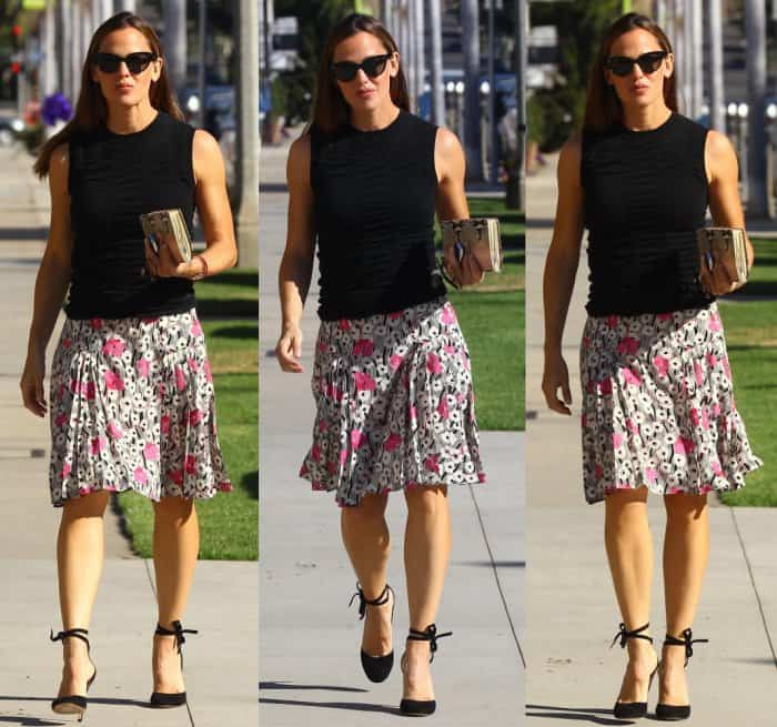 "Jennifer Garner in a floral pleated skirt, black blouse and Gianvito Rossi ""Carla"" ankle tie pumps."