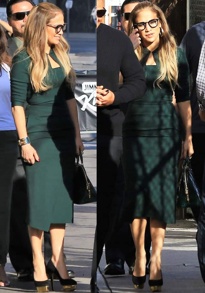 Jennifer looks low-key in a moss green dress by Roland Mouret