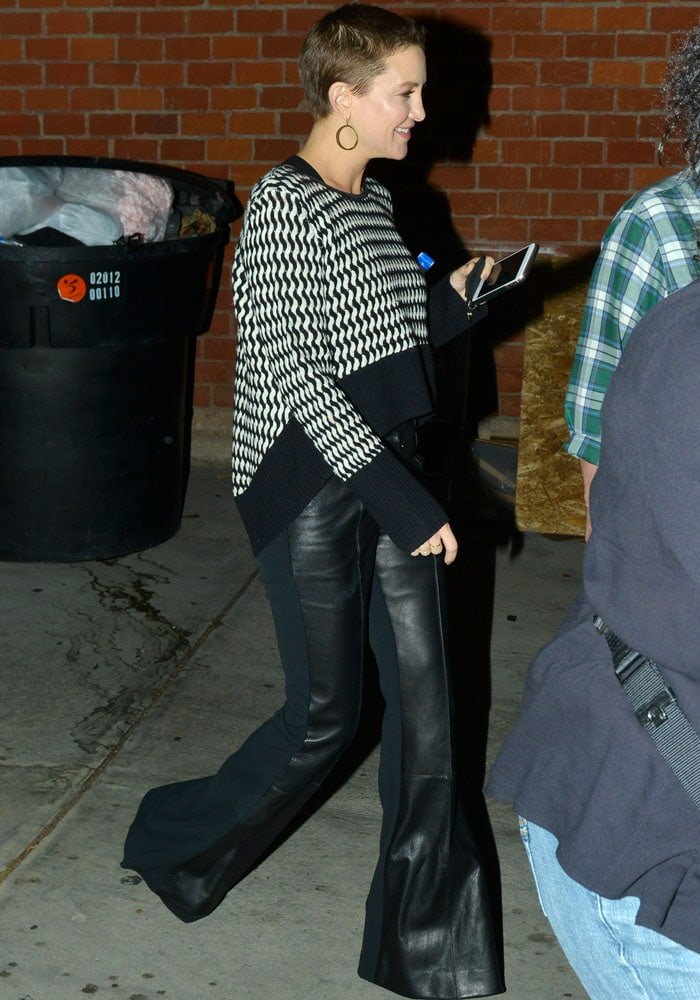 Kate steps out in a David Koma leather and stretch cady flared pants