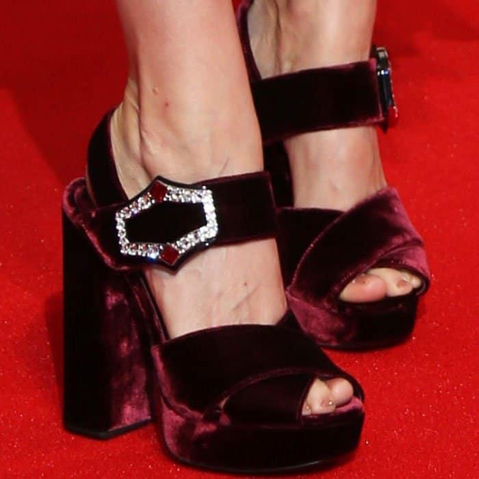 The actress towers in a pair of Prada velvet platform sandals