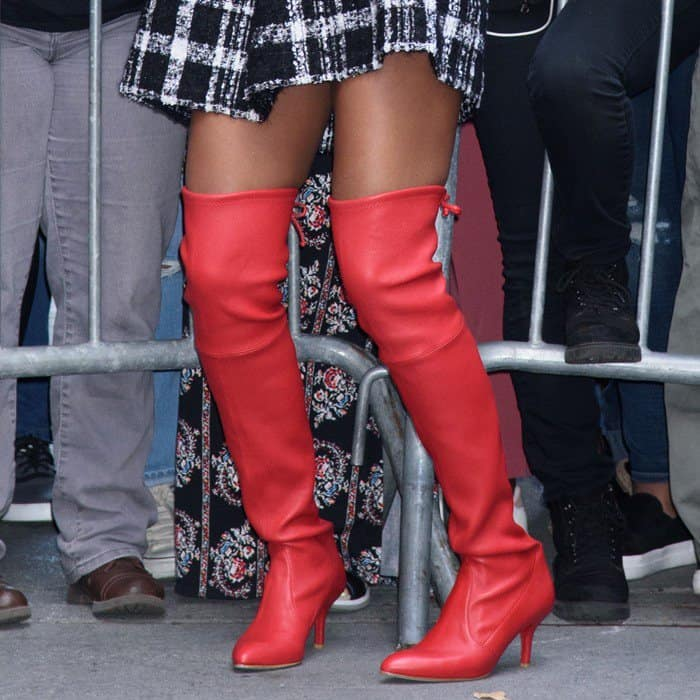 Kerry Washington wearing red stretch leather 'Tiemodel' boots from Stuart Weitzman