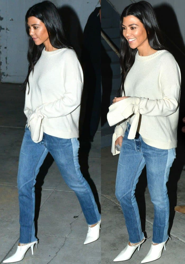 "Kourtney wears a cozy Designer Remix ""Sydni"" sweater with bow sleeves"