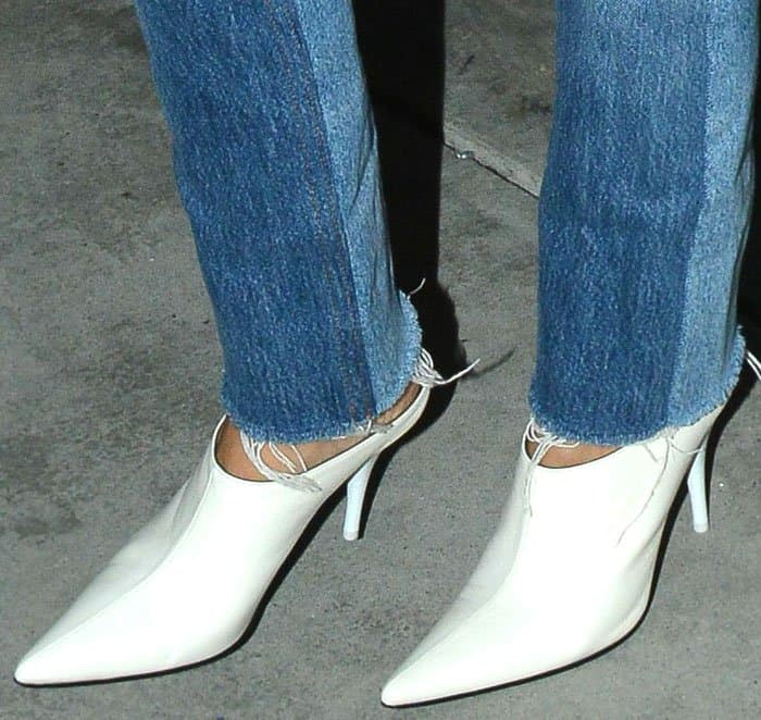 Kourtney adds a chic touch to her outfit with a pair of Céline pointed toe mules