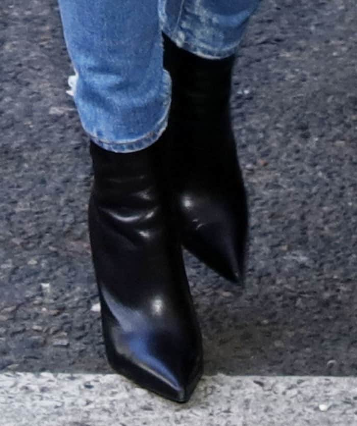 "Kourtney wears her Balenciaga ""Knife"" boots several times during the trip"