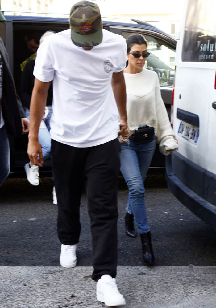 Kourtney and her boyfriend Younes Bendjima emerge from a car in Paris