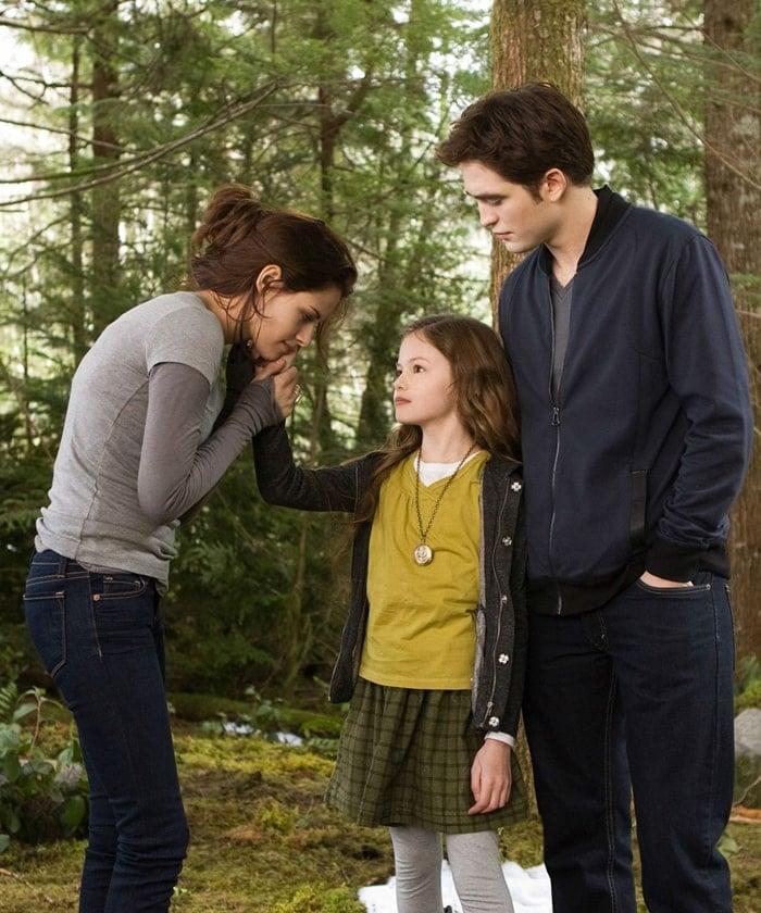 Mackenzie Foy as Renesmee Cullen with her on-screen parents Kristen Stewart and Robert Pattinson in The Twilight Saga: Breaking Dawn – Part 2