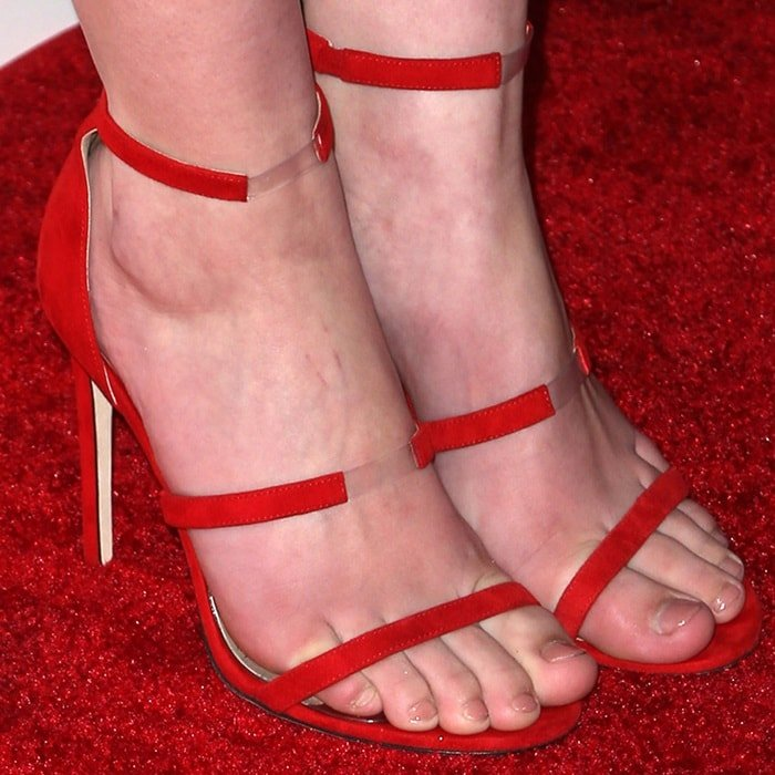 Mackenzie Foy showing off her feet in Tamara Mellon shoes