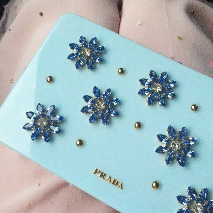 Mackenzie uploads a close up of her gorgeous Prada clutch