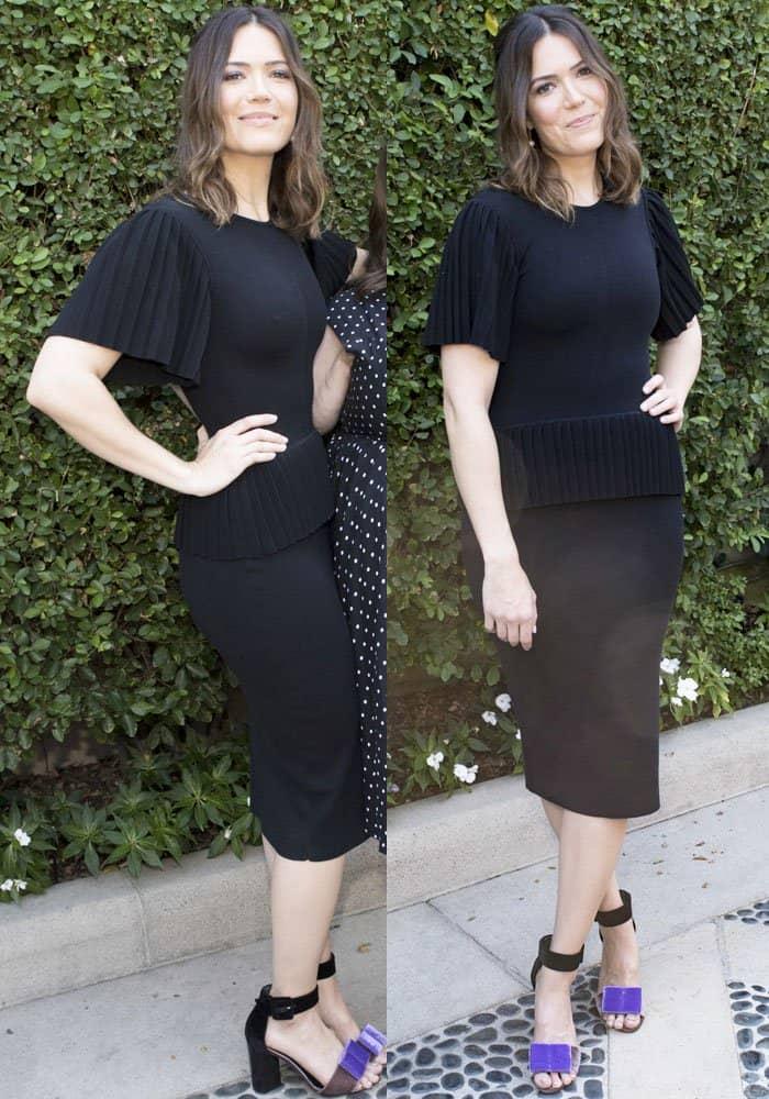 Mandy kept it classy in a pleated Altuzarra dress