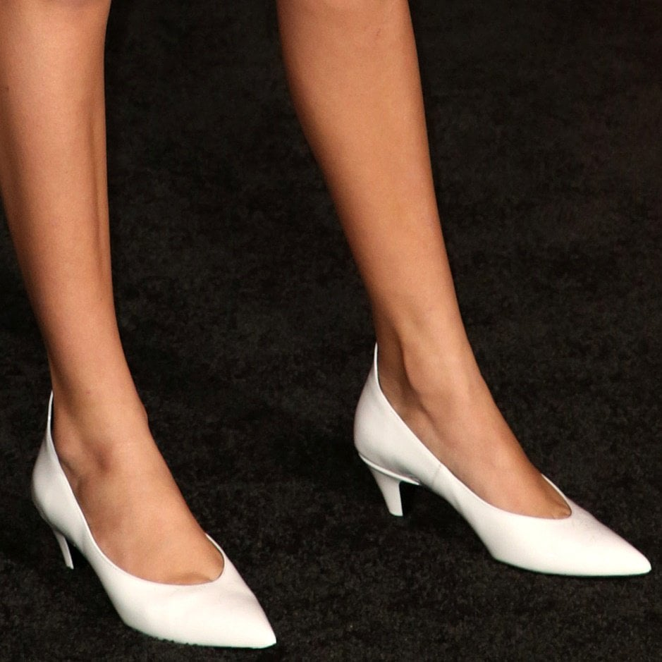 Millie Bobby Brown shows off her feet in white patent pumps from Calvin Klein