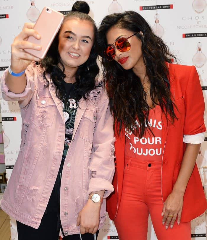 Nicole poses for a selfie with a fan